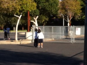 C and T at school. (Don't worry, I was kidding about keeping an eye on him. This picture was actually taken by his mom.)